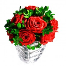 Arrangement with roses in crystal pot
